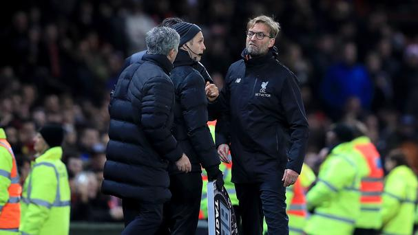 Jurgen Klopp, right, saw his side let their lead slip at Old Trafford