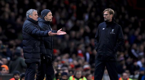 Jose Mourinho, pictured left, and Jurgen Klopp, right, had a heated exchange towards the end of the game
