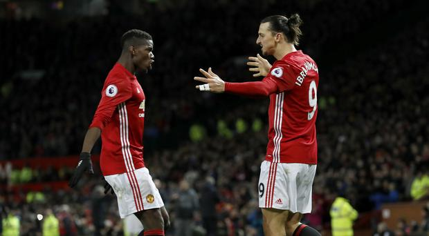 Zlatan Ibrahimovic, right, says dealing with the media pressure on himself and Paul Pogba is child's play