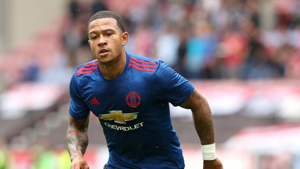 NOT OVER? Man Utd demand buy-back option in Memphis Lyon deal