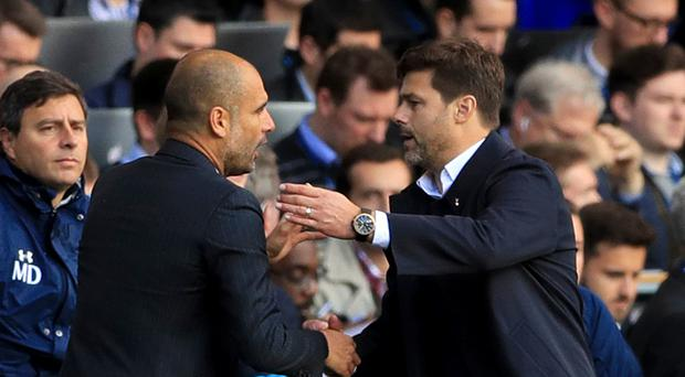 Mauricio Pochettino, right, believes Pep Guardiola only needs time to bring sustained success to Manchester City