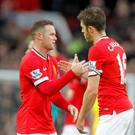 Michael Carrick, pictured right, and Wayne Rooney, left, have been Manchester United team-mates since 2006