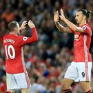Zlatan Ibrahimovic, right, struggles to understand why his team-mate Wayne Rooney, left, is not cherished