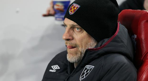 West Ham manager Slaven Bilic is resting at home following a stay in hospital with a bad case of flu
