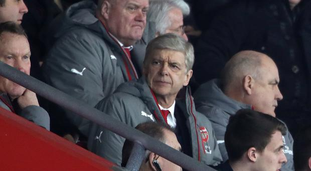 Arsene Wenger watched from the stands as Arsenal swatted Southampton aside 5-0 at St Mary's on Saturday