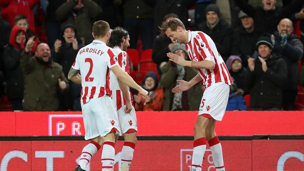 Stoke's Peter Crouch (right) pulls out his signature celebration after netting his 100th Premier League strike