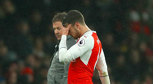 Aaron Ramsey limped out of Arsenal's defeat to Watford after suffering a calf strain