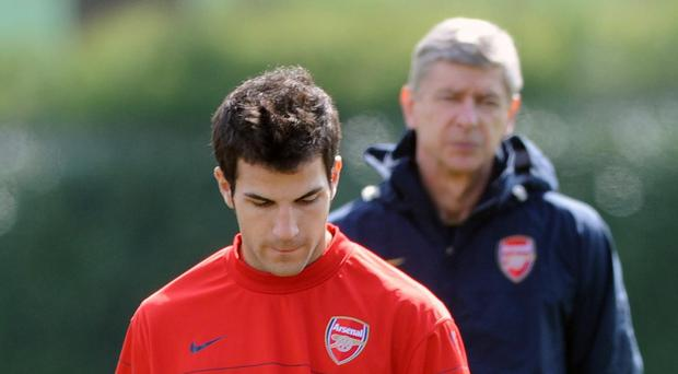 Cesc Fabregas (front) says he will always be grateful to Arsenal and Gunners manager Arsene Wenger (back)