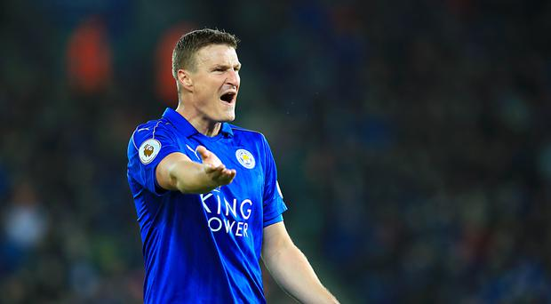 Robert Huth helped Leicester beat the drop in 2015