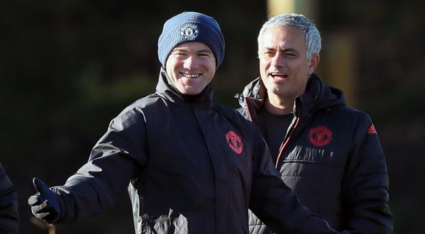 Manchester United captain Wayne Rooney, left, is enjoying life under Jose Mourinho