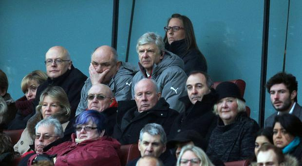 Arsene Wenger, pictured centre, served the final game of his four-match touchline ban