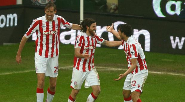 Stoke City's Joe Allen (centre) celebrates scoring the only goal of the game