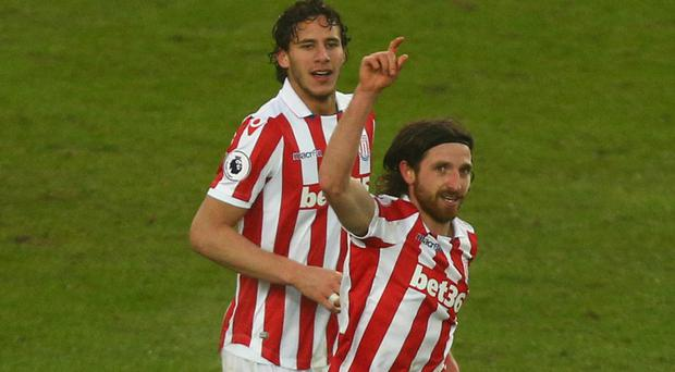 Stoke's Joe Allen, right, celebrates scoring the only goal of the game