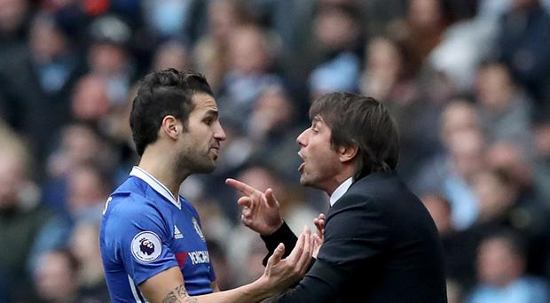 Head coach Antonio Conte, right, believes Cesc Fabregas, left, is Chelsea's answer to Andrea Pirlo
