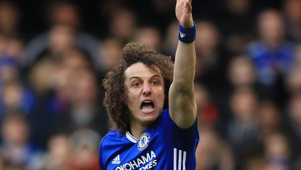 Chelsea's David Luiz continues to receive treatment on a knee injury sustained in December