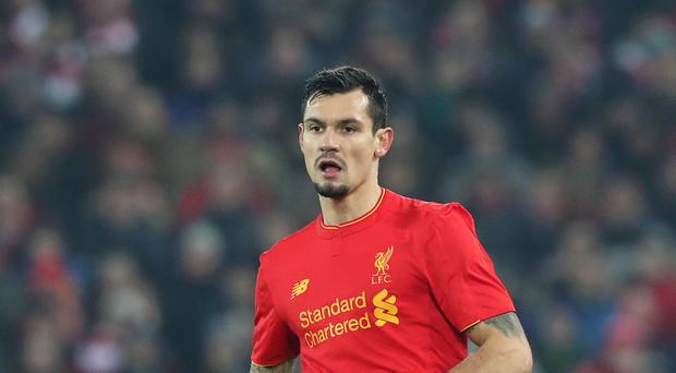 Defender Dejan Lovren has not travelled to Liverpool's warm weather training camp in Spain.