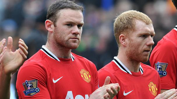 Wayne Rooney, left, could leave Manchester United according to Paul Scholes, right