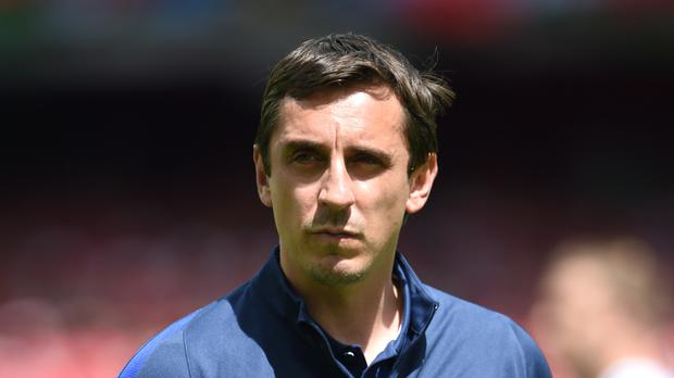 Gary Neville has defended Arsenal manager Arsene Wenger