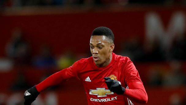 Manchester United's Anthony Martial says he is happy at the club