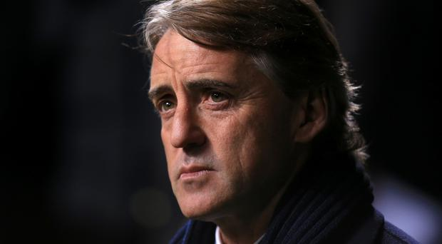 Roberto Mancini led Manchester City to the Premier League title in 2012.