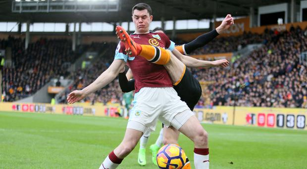 Burnley's Michael Keane gets in a tangle in an eventful match for the defender
