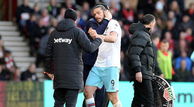 Slaven Bilic hopes to have Andy Carroll, centre, back to face Chelsea