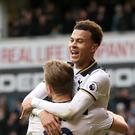 Dele Alli celebrates scoring his goal with Harry Kane