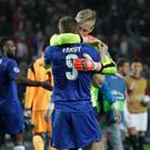 Winning feeling: Jamie Vardy embraces Kasper Schmeichel