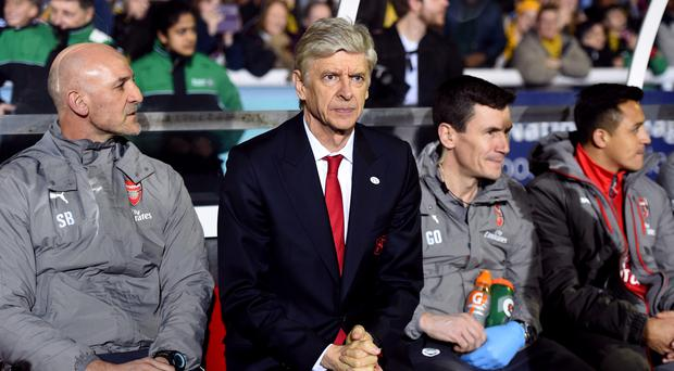Arsene Wenger has likened football management to being a priest
