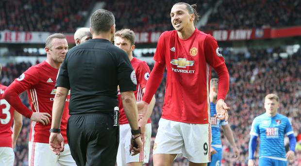 Zlatan Ibrahimovic, right, escaped punishment following a first-half elbow on Tyrone Mings