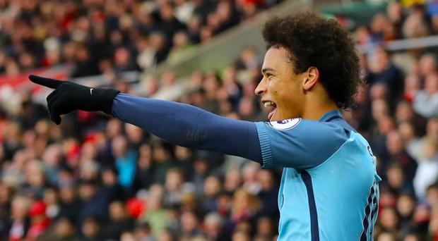 Leroy Sane celebrates City's second of the afternoon