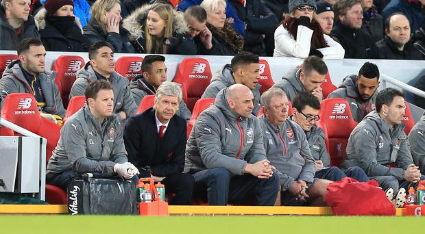 Alexis Sanchez was left sat behind Arsene Wenger for the first half at Anfield