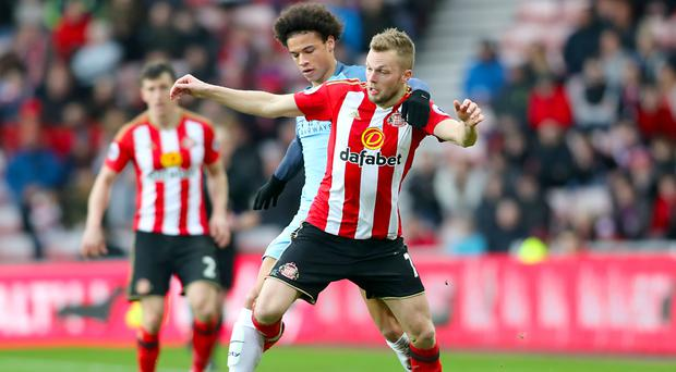 Sunderland midfielder Sebastian Larsson (right) has vowed to carry on fighting for Premier League survival