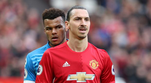 Tyrone Mings (left) and Zlatan Ibrahimovic (right) clashed on Saturday