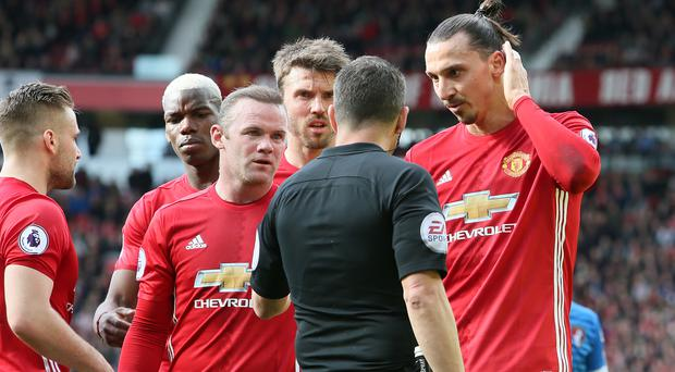 Manchester United's Zlatan Ibrahimovic (right) and Wayne Rooney (left) appeal to referee Kevin Friend