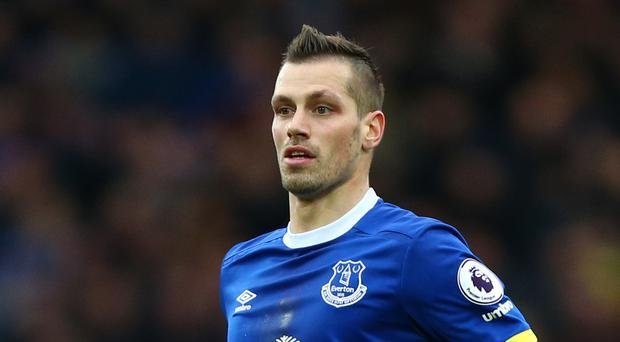 Midfielder Morgan Schneiderlin admits Everton have to be patient in their quest for Champions League football.