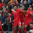 Emre Can, pictured centre, was Liverpool's match-winner against Burnley