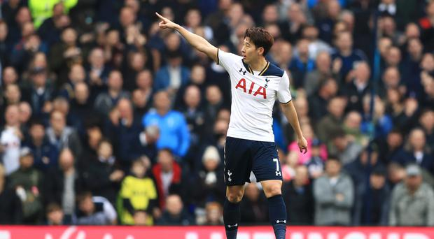 Tottenham striker Son Heung-min scored a hat-trick to sink Millwall