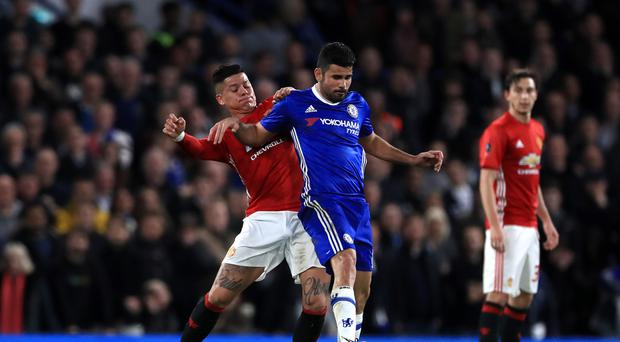 Marcos Rojo (left) and Diego Costa (right) had an ongoing battle at Stamford Bridge