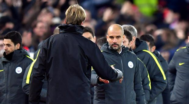 Pep Guardiola won a German Cup but trails in the overall head-to-head against Jurgen Klopp, left
