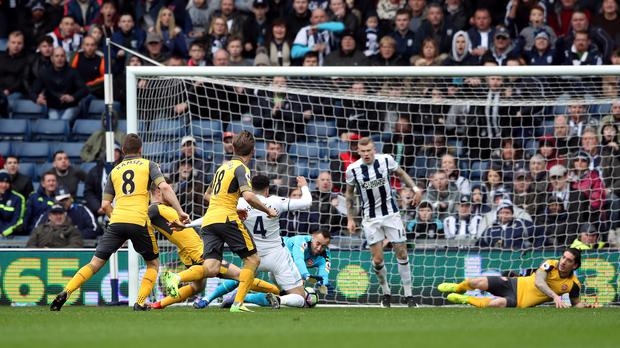 Hal Robson-Kanu, centre, puts West Brom back ahead in their 3-1 win over Arsenal