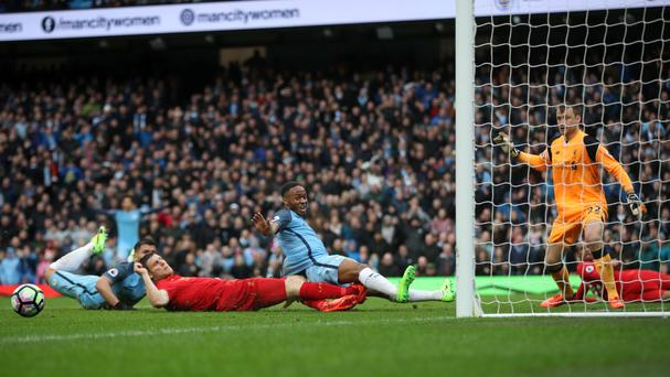 Raheem Sterling, centre right, missed a glaring opportunity in the first half for Manchester City