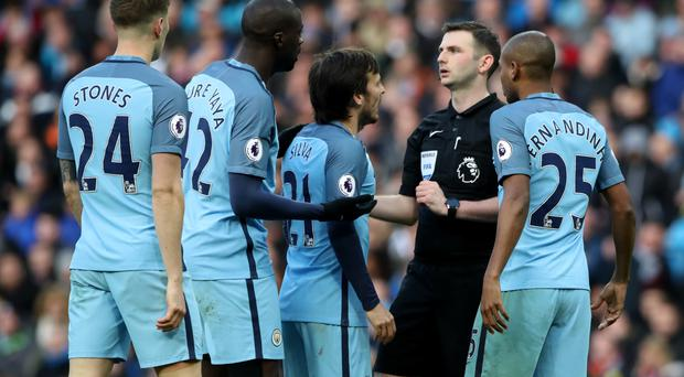 Manchester City have been charged with failing to control their players