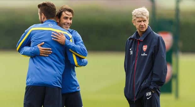 Robert Pires, centre, believes Arsene Wenger, right, will agree to stay on as Arsenal boss