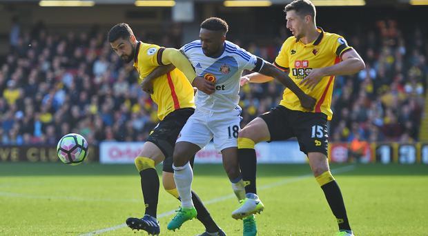 Sunderland's Jermain Defoe, centre, battles with Watford's goalscorer Miguel Britos, left, and Craig Cathcart