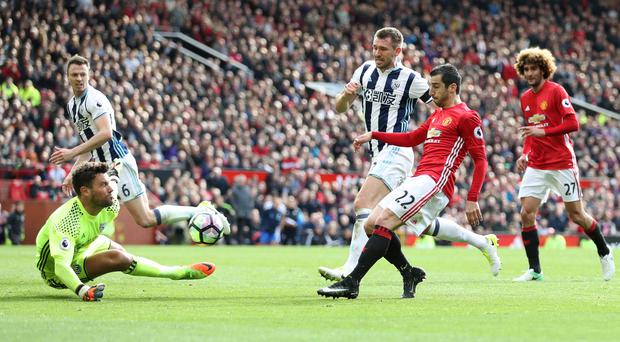 West Brom goalkeeper Ben Foster makes a save in a man-of-the-match performance