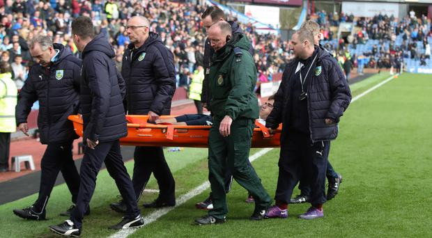 Harry Winks was carried off on a stretcher at Turf Moor
