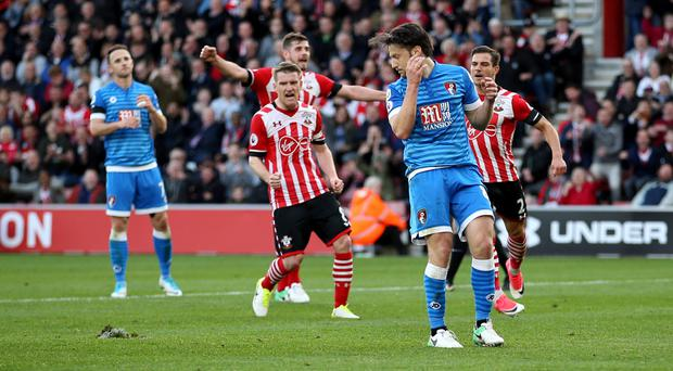 Bournemouth's Harry Arter slipped as he went to take his missed penalty at Southampton