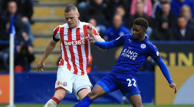 Leicester's Demarai Gray, right, battles with Stoke's Ryan Shawcross in the Foxes' 2-0 win on Saturday