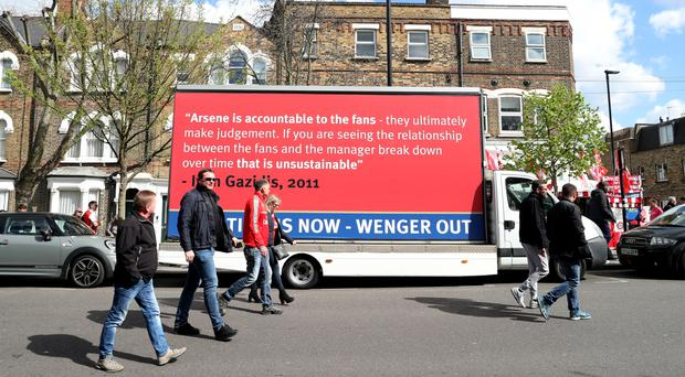A van carrying anti-Arsene Wenger quotes parked up outside the Emirates Stadium